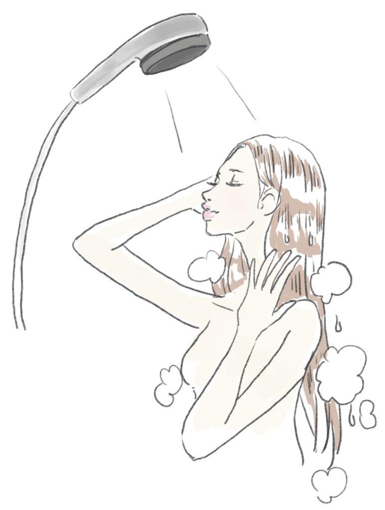 シャンプーをすすぐ女性